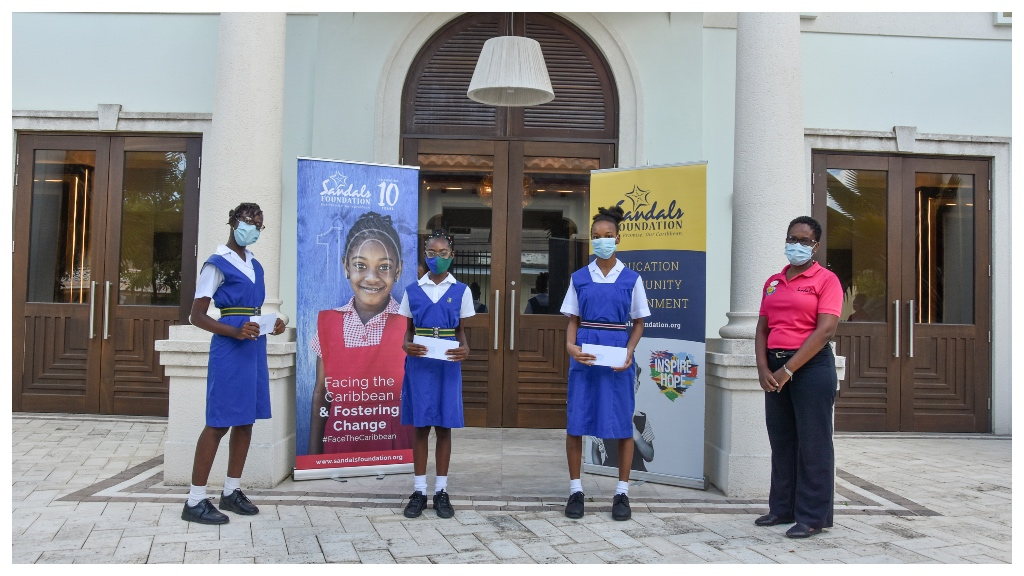 Sandals Barbados Public Relations Coordinator Stacia Brathwaite (Right) with three of the Sandals Foundation Care For Kids Scholarship recipients.