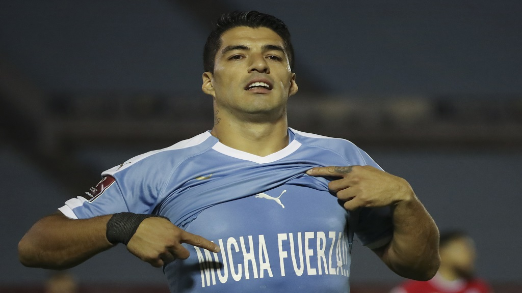 Uruguay's Luis Suarez celebrates scoring the opening goal against Chile during a qualifying football match for the FIFA World Cup Qatar 2022 at the Centenario stadium in Montevideo, Uruguay, Thursday, Oct. 8, 2020. (Raul Martinez/Pool via AP).