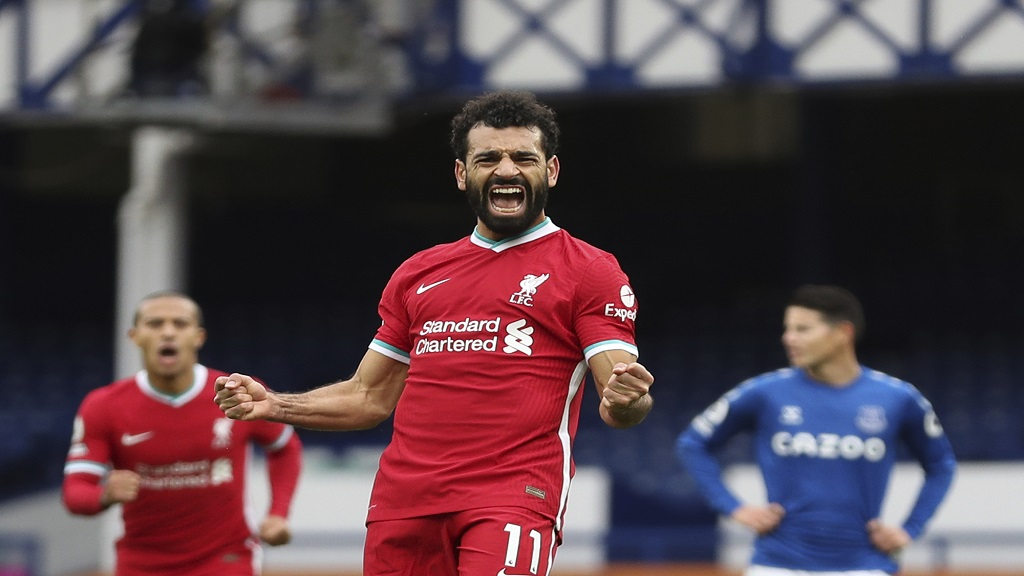 Liverpool's Mohamed Salah, 11, celebrates scoring his side's second goal during the English Premier League football match against Everton at Goodison Park stadium, in Liverpool, England, Saturday, Oct. 17, 2020. (Cath Ivill/Pool via AP).