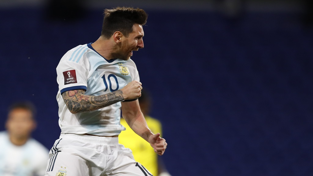 Argentina's Lionel Messi celebrates after scoring during a qualifying football match against Ecuador for the FIFA World Cup Qatar 2022 at the Bombonera stadium in Buenos Aires, Argentina, Thursday, Oct. 8, 2020.(Agustin Marcarian/Pool via AP).