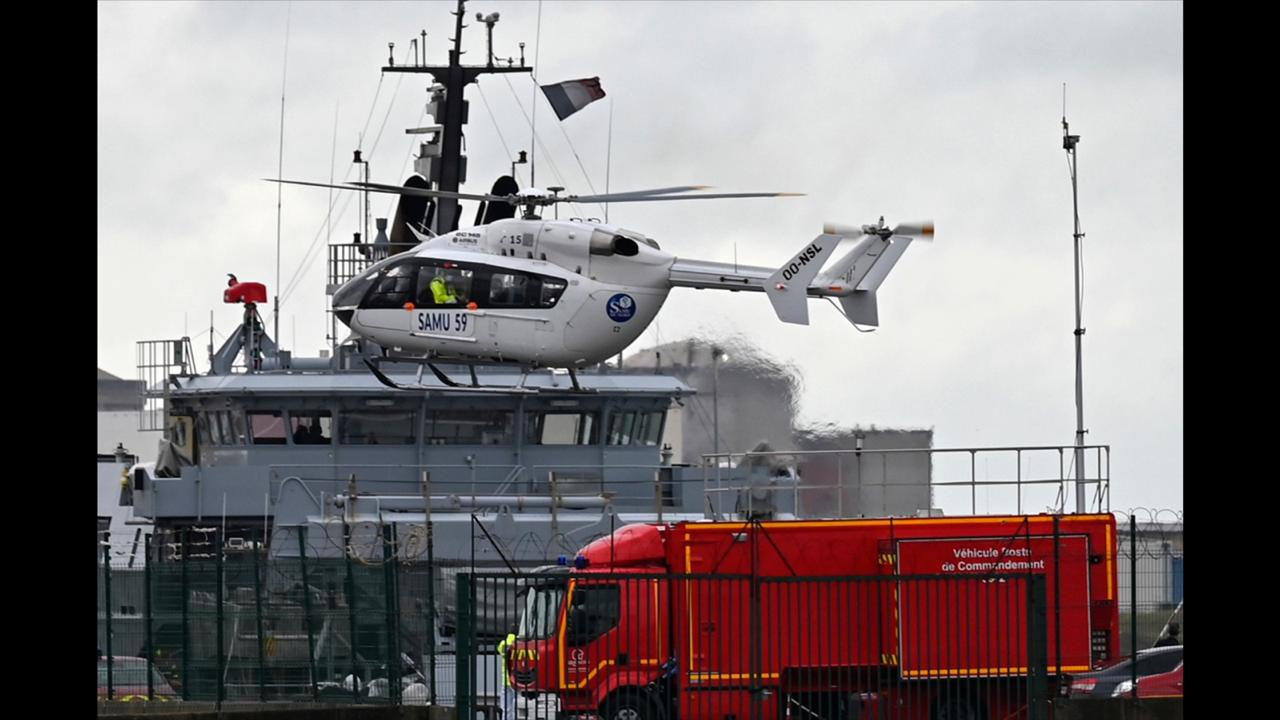 A French rescue helicopter lands close to a rescue vessel in Dunkirk, northern France, Tuesday, October 27, 2020 during a  search operation after four migrants, including a 5-year-old and 8-year-old child died Tuesday when their boat capsized while they and other migrants tried to cross the English Channel to Britain, French authorities said. (AP Photo)