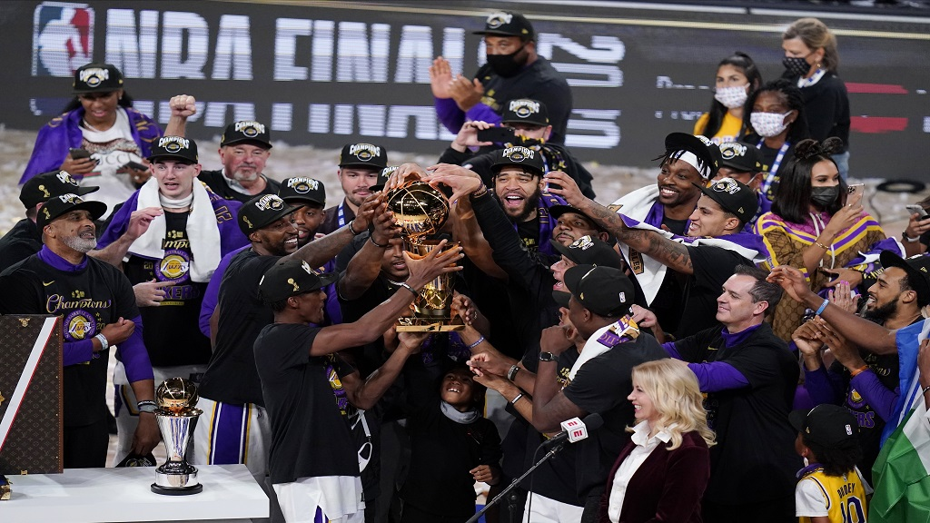 The Los Angeles Lakers players celebrate after the Lakers defeated the Miami Heat 106-93 in Game 6 of basketball's NBA Finals on Sunday, Oct. 11, 2020, in Lake Buena Vista, Fla. (AP Photo/John Raoux).