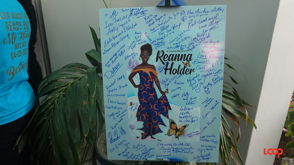Mourners signed the card outside Coral Ridge Memorial Chapel for Reanna Holder