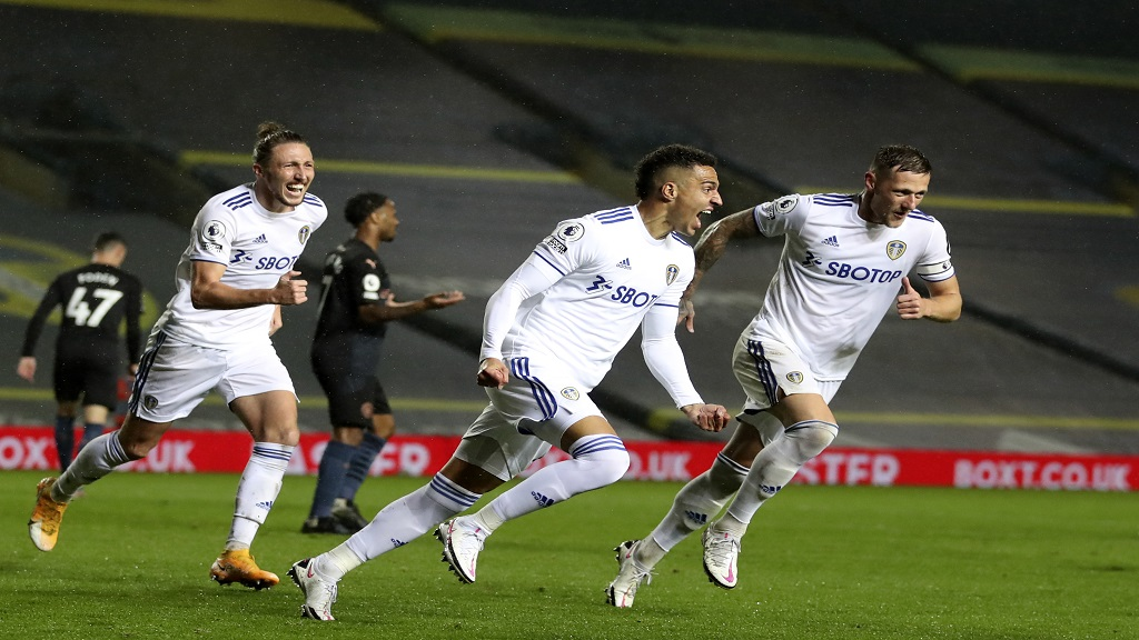 Leeds United's Rodrigo, centre, celebrates after equalising against Manchester City during their English Premier League match at Elland Road in Leeds, England, Saturday, Oct. 3, 2020. (Cath Ivill/Pool via AP).