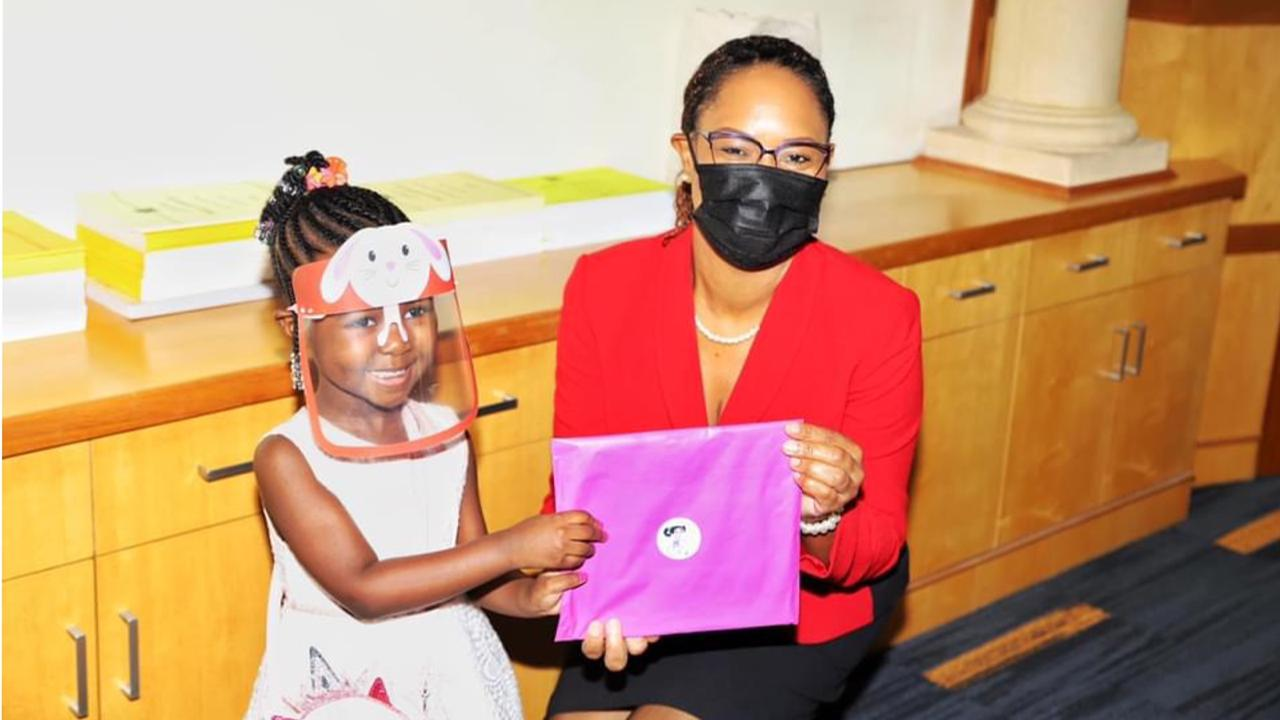 Author Coryn Clarke with Minister Ayanna Webster-Roy at the Office of the Prime Minister.