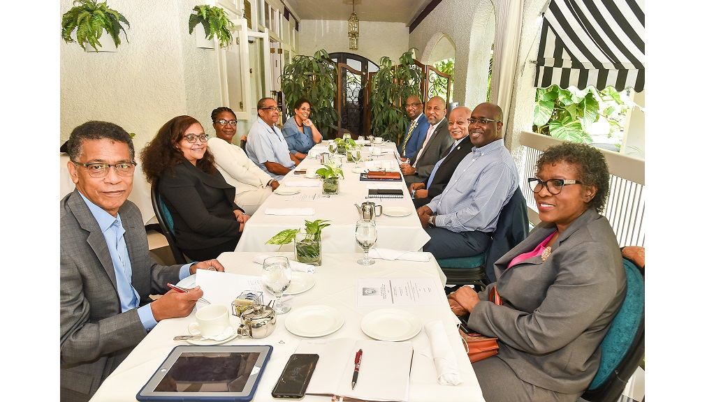 Members of the UCC Chancellor's Forum (l-r) Dr Archibald Campbell, Geraldine Adams, Sherene Todd, Ian Randle, Dr Angela Ramsay, Dr Winston Adams, Dr Wayne Henry, Chancellor Sir Kenneth Hall, Gary Allen, and Audrey Sewell.