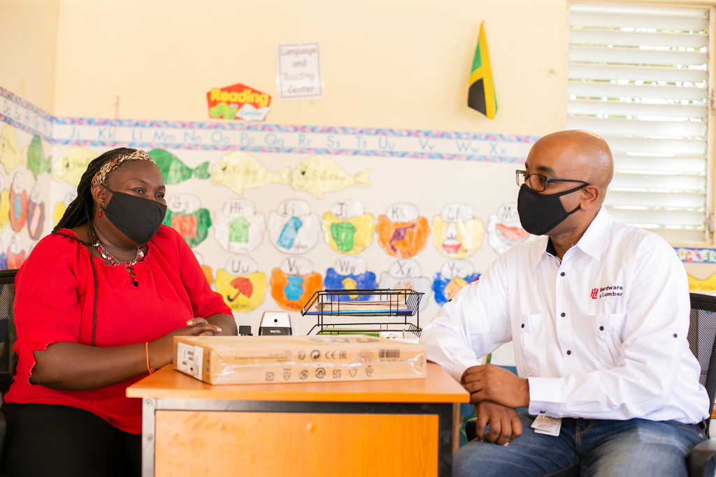 Sharon Byfield, Principal at the Clifton Basic School in Bernard Lodge Portmore, explains to Gordon Webster, General Manager of Technology and eChannels at Hardware & Lumber Limited, some of the difficulties her school currently faces as they transition to remote learning for the upcoming academic year.