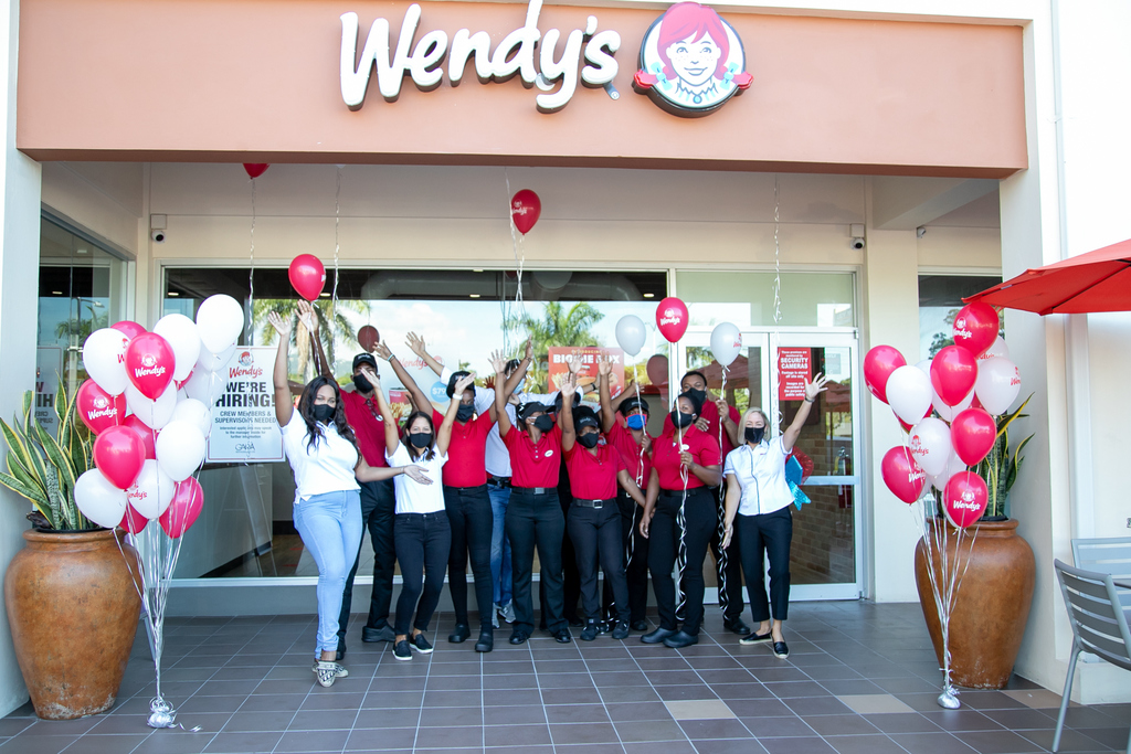 Wendy's Constant Spring and Gara Restaurants team members in front of the new restaurant.