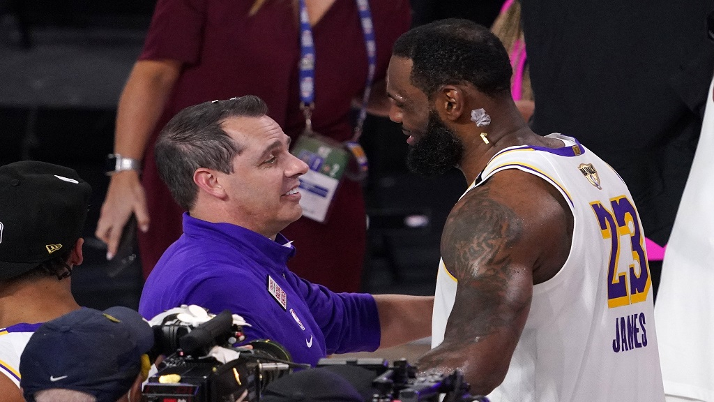 Los Angeles Lakers head coach Frank Vogel hugs LeBron James after the Lakers defeated the Miami Heat 106-93 in Game 6 of basketball's NBA Finals Sunday, October 11, 2020, in Lake Buena Vista, Florida. (AP Photo/Mark J. Terrill)