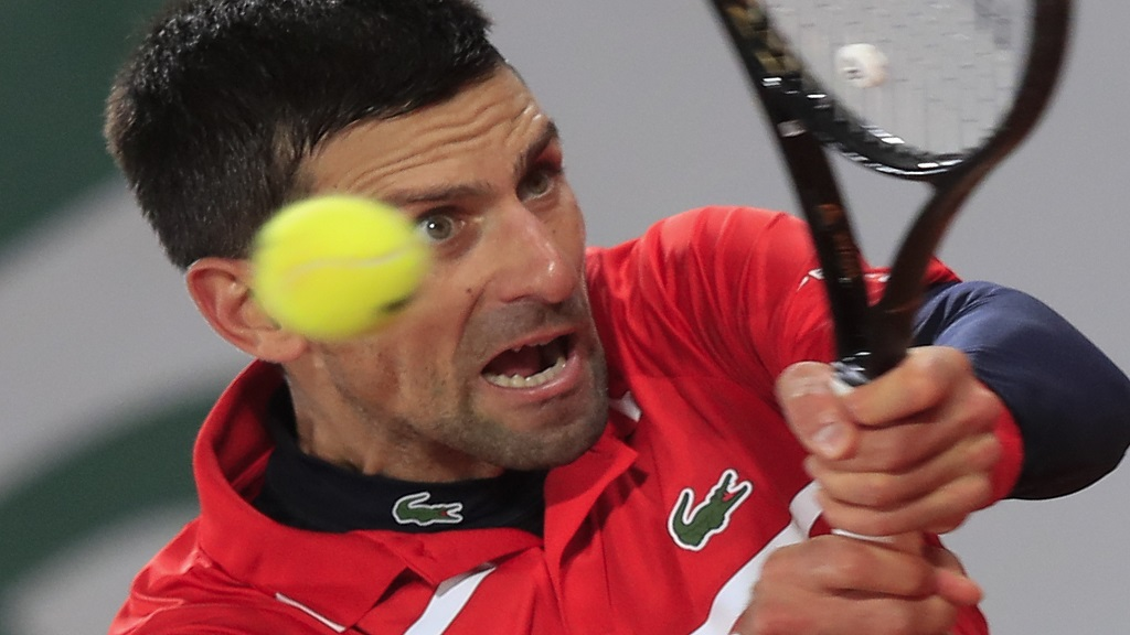 Serbia's Novak Djokovic plays a shot against Russia's Karen Khachanov in the fourth round match of the French Open tennis tournament at the Roland Garros stadium in Paris, France, Monday, Oct. 5, 2020. (AP Photo/Michel Euler).