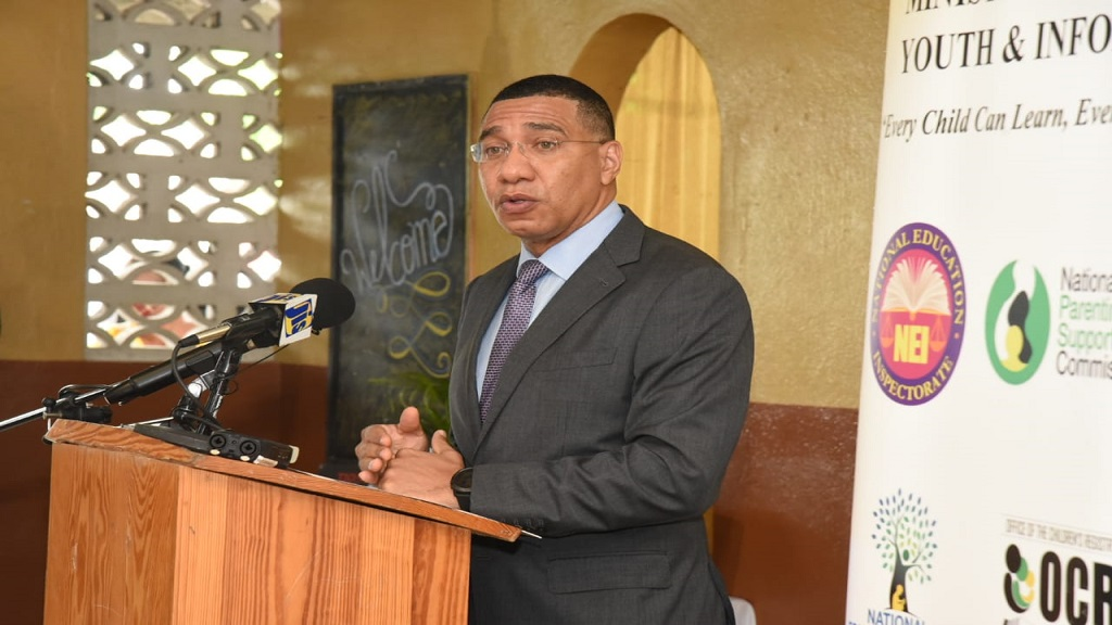 Prime Minister Andrew Holness at the handing over of devices under the Tablets in Schools programme at Drews Avenue Primary and Infant School in St Andrew on Wednesday.