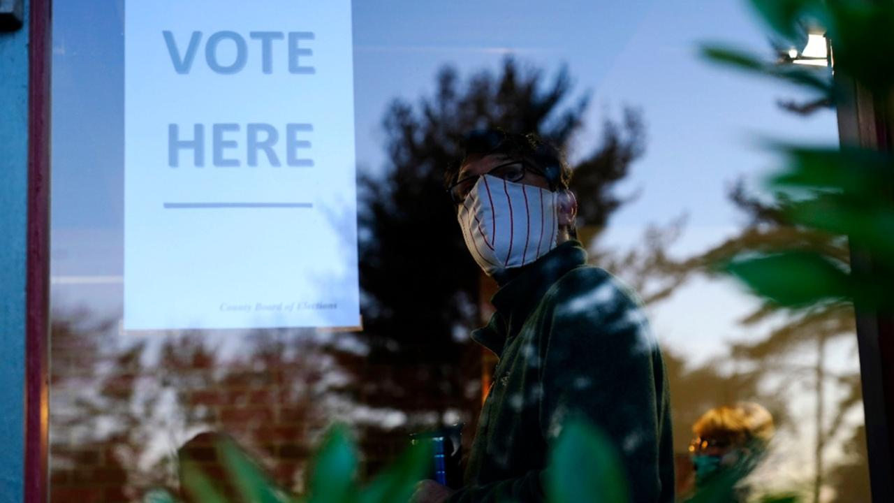 In this November 3, 2020, file photo, voter lines up in a polling place to cast a ballot for the 2020 general election in the United States in Springfield, Pa.  (AP Photo/Matt Slocum, File)