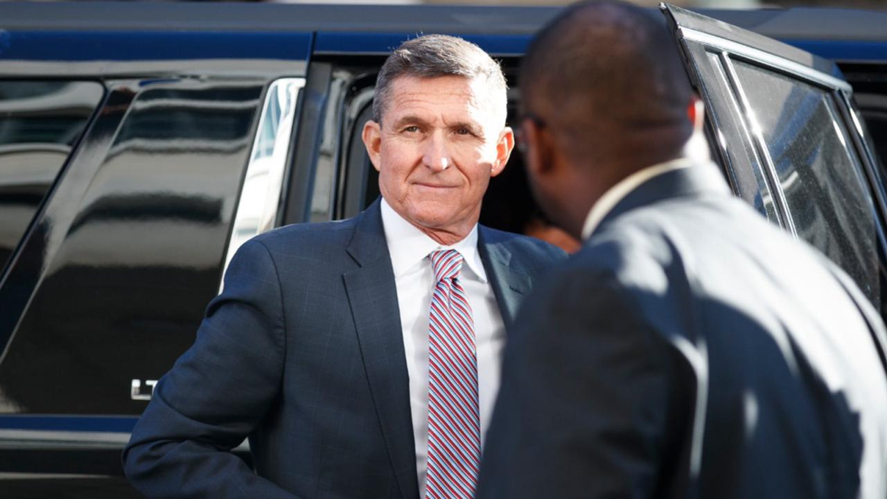 President Donald Trump's former National Security Advisor Michael Flynn arrives at federal court in Washington, Tuesday, December 18, 2018. (AP Photo/Carolyn Kaster)