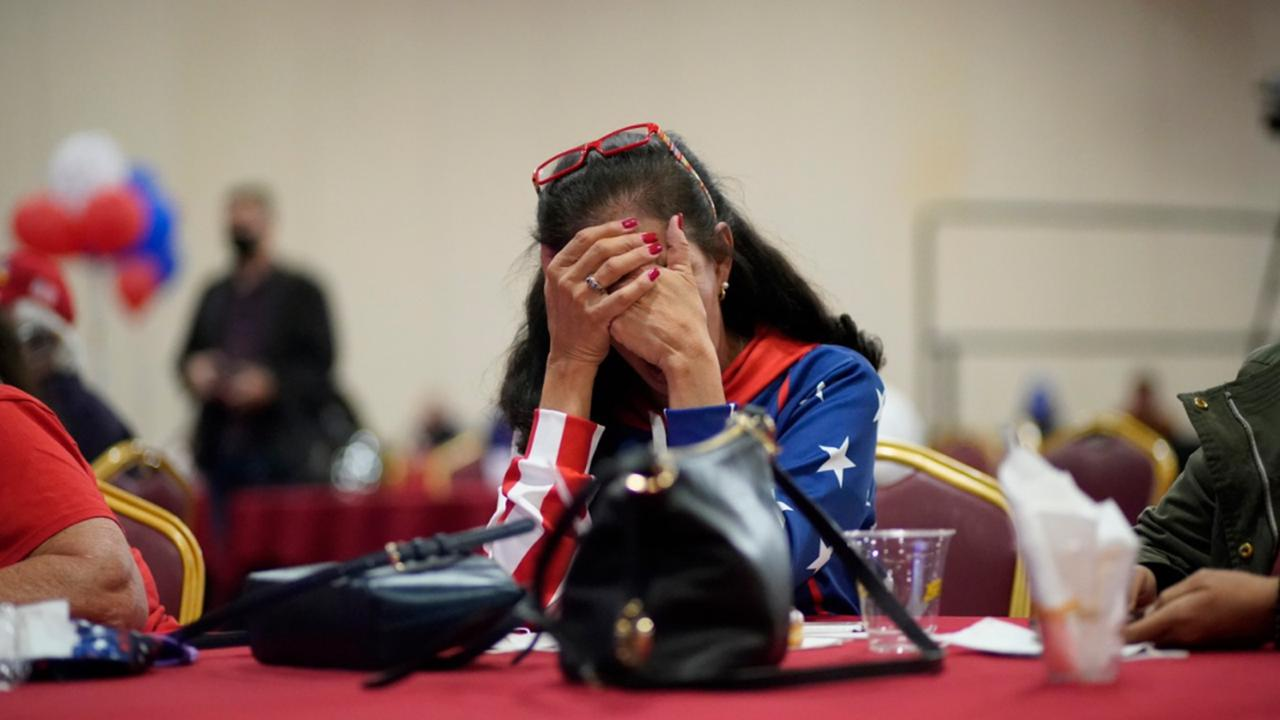 President Donald Trump supporter Loretta Oakes reacts while watching returns in favour of Democratic presidential candidate former Vice President Joe Biden, at a Republican election-night watch party, Tuesday, November 3, 2020, in Las Vegas. (AP Photo/John Locher)
