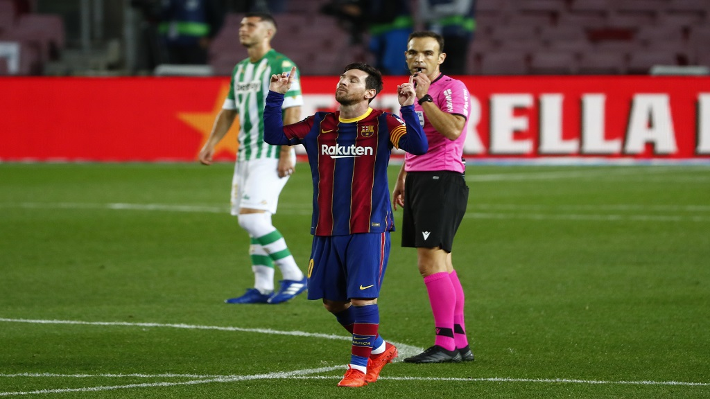 Barcelona's Lionel Messi celebrates after scoring his side's fourth goal during the Spanish La Liga football match against Betis at the Camp Nou stadium in Barcelona, Spain, Saturday, Nov. 7, 2020. (AP Photo/Joan Monfort).