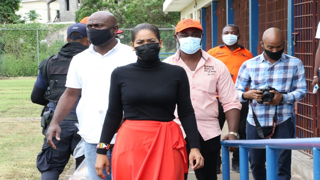 Defeated People's National Party presidential aspirant, Lisa Hanna, with supporters during the party's election on Saturday.