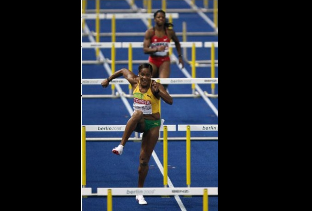 Jamaica's Brigitte Foster-Hylton on her way to an historic gold medal in the women's 100m hurdles final race of the 2009 IAAF Athletics World Championships in Berlin on August 19, 2009.