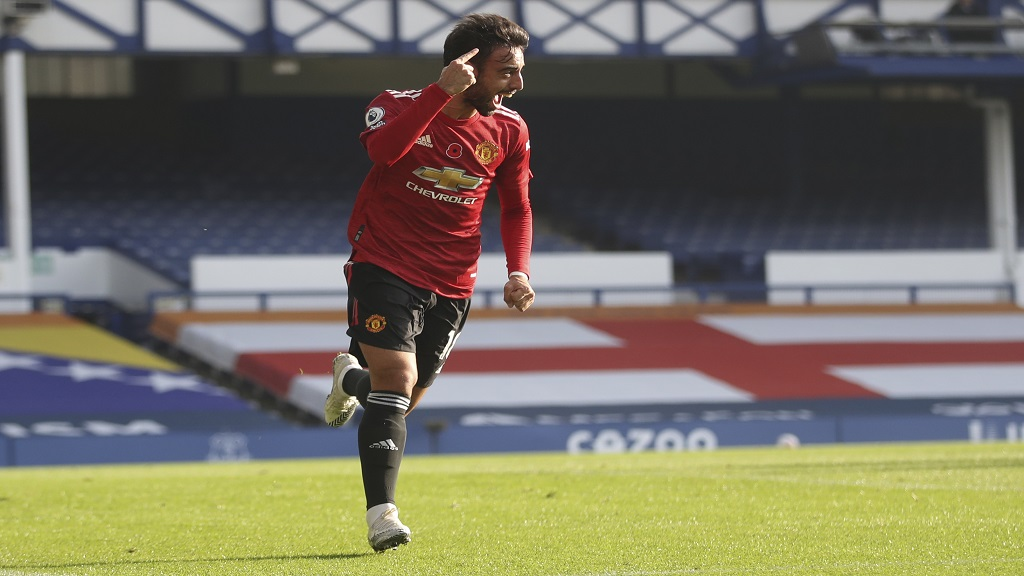 Manchester United's Bruno Fernandes celebrates after scoring his side's opening goal during the English Premier League football match against Everton at the Goodison Park stadium in Liverpool, England, Saturday, Nov. 7, 2020. (Carl Recine/Pool via AP).