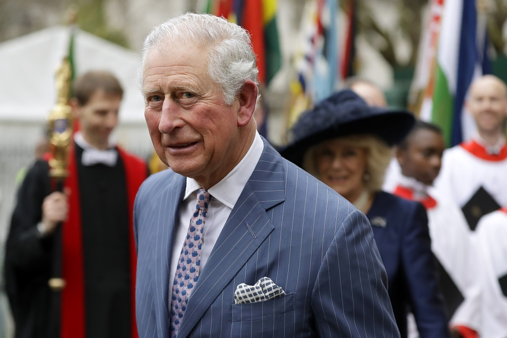 FILE - In this Monday, March 9, 2020 file photo, Britain's Prince Charles and Camilla the Duchess of Cornwall, in the background, leave after attending the annual Commonwealth Day service at Westminster Abbey in London. (AP Photo/Kirsty Wigglesworth, File)
