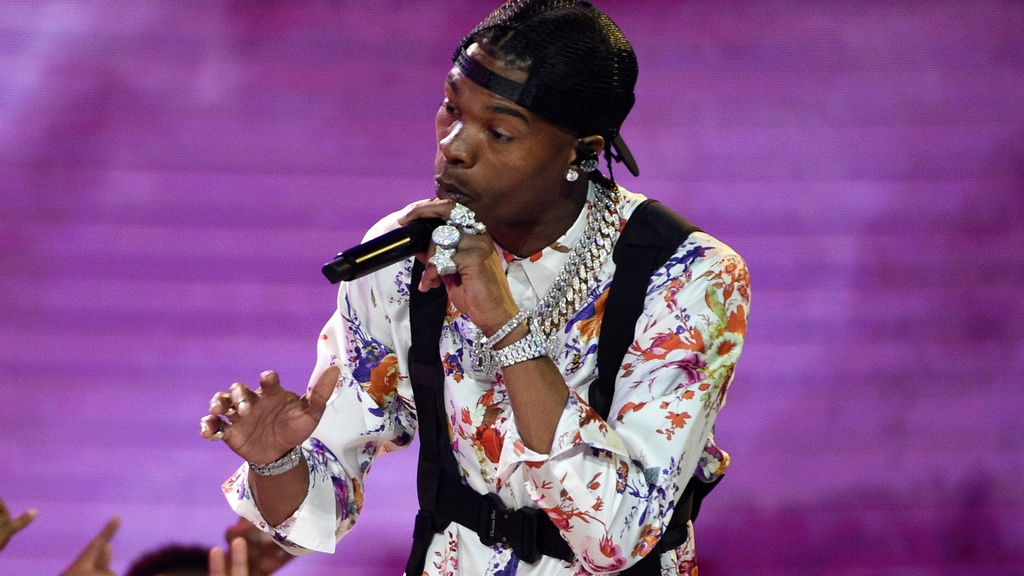 FILE - Lil Baby performs at the BET Awards in Los Angeles on June 23, 2019. Rapper Lil Baby has been named artist of the year at the second annual Apple Music Awards. (Photo by Chris Pizzello/Invision/AP, File)
