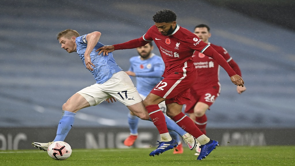 Liverpool's Joe Gomez, right, challenges Manchester City's Kevin De Bruyne during an English Premier League football match at the Etihad stadium in Manchester, England, Sunday, Nov. 8, 2020. (Shaun Botterill/Pool via AP).