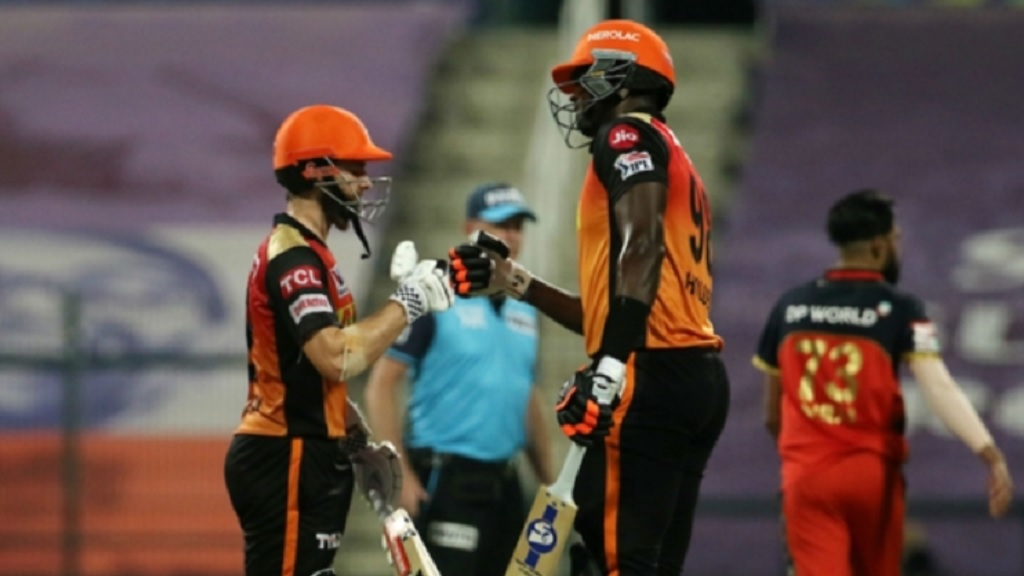 Sunrisers Hyderabad's Jason Holder (right) and Kane Williamson touch gloves during their fifth-wicket unbeaten stand of 65 in the IPL eliminator match against Royal Challenger Bangalore, on Friday, at the Zayed Cricket Stadium.