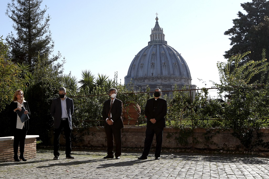 "From left, Rosetta Sannelli, director of the Kineo Movie for Humanity Award, director Evgeny Afineevsky, Paolo Ruffini, prefect of the dicastery of Communication, and Monsignor Ruiz, secretary of the dicastery, pose for a photo respecting the social distancing during the award ceremony at the Vatican, Thursday, October 22, 2020. Director Evgeny Afineevsky was awarded with Kineo prize Thursday for the movie ""Francesco"". (AP Photo/Alessandra Tarantino)"