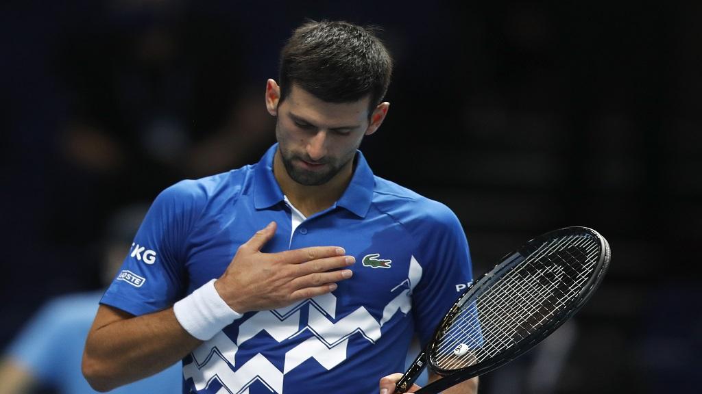 Novak Djokovic of Serbia celebrates winning match point against Diego Schwartzman of Argentina during their singles tennis match at the ATP World Finals tennis tournament at the O2 arena in London, Monday, Nov. 16, 2020. (AP Photo/Frank Augstein).