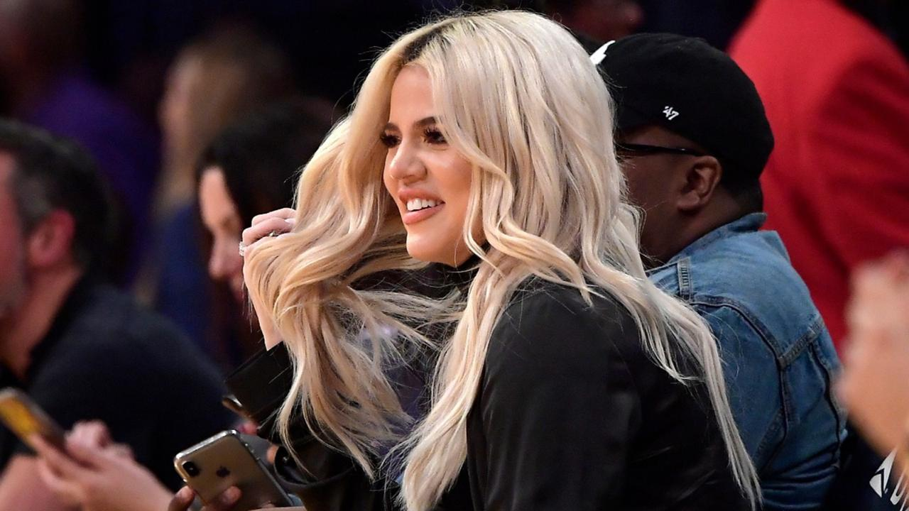 In this January 13, 2019, file photo, Khloe Kardashian watches during the second half of an NBA basketball game between the Los Angeles Lakers and the Cleveland Cavaliers in Los Angeles. Kardashian says she had tested positive for the coronavirus (AP Photo/Mark J. Terrill, File)