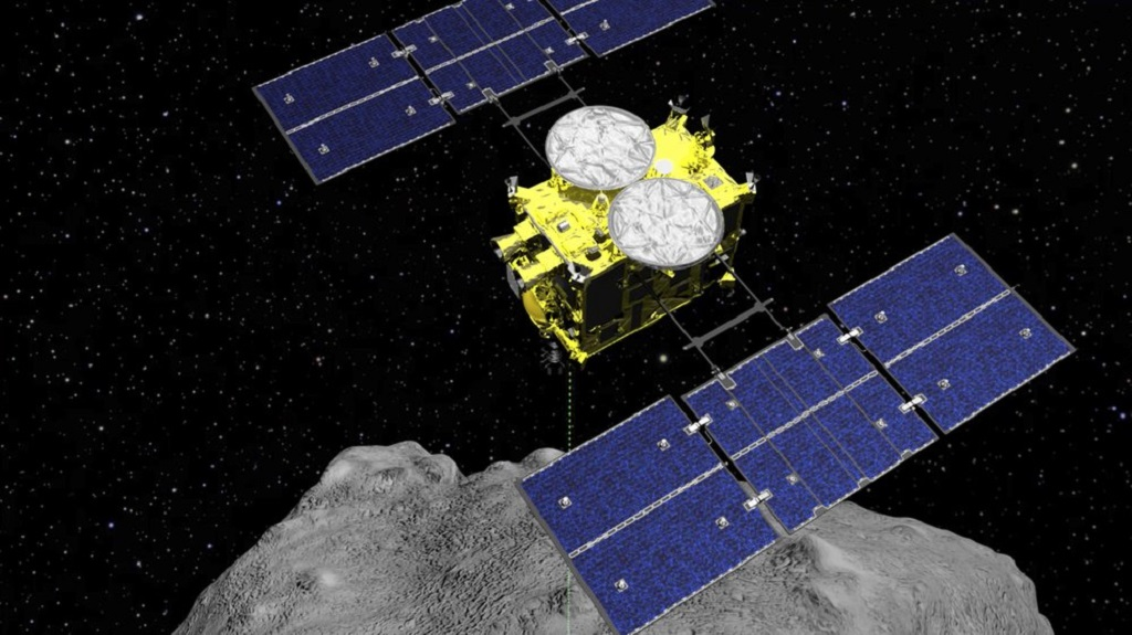 FILE - This computer graphics image released by the Japan Aerospace Exploration Agency (JAXA) shows the Hayabusa2 spacecraft above the asteroid Ryugu. The Japanese spacecraft is nearing Earth after a yearlong journey home from a distant asteroid carrying soil samples and data that could provide clues to the origins of the solar system, a space agency official said Friday, Nov. 27, 2020. (ISAS/JAXA via AP, File)