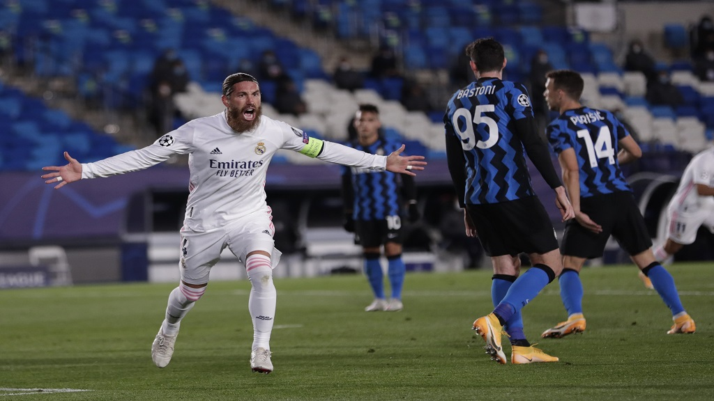 Real Madrid's Sergio Ramos celebrates after scoring his side's second goal during the Champions League group B football match against Inter Milan at the Alfredo Di Stefano stadium in Madrid, Spain, Tuesday, Nov. 3, 2020. (AP Photo/Bernat Armangue).