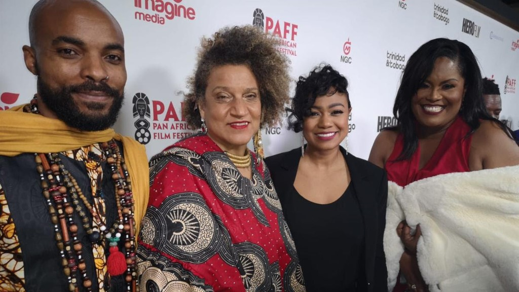 HERO, the movie inspied by the life of Ulric Cross, wil be shown on Showtime. In this photo, Director of the movie, Frances Anne Solomon and Executive Producer Lisa Wickham pose with star of the movie Nickolai Salcedo and actress Tatyana Ali in Los Angeles.