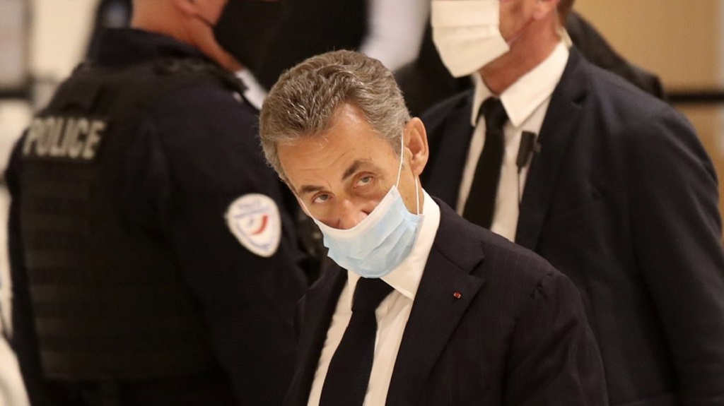Former French President Nicolas Sarkozy arrives at the courtroom, Monday, November 23, 2020 in Paris. Former French President Nicolas Sarkozy goes on trial Monday on charges of corruption and influence peddling in a phone-tapping scandal, a first for the 65-year-old politician who has faced several other judicial investigations since leaving office in 2012. (AP Photo/Michel Euler)