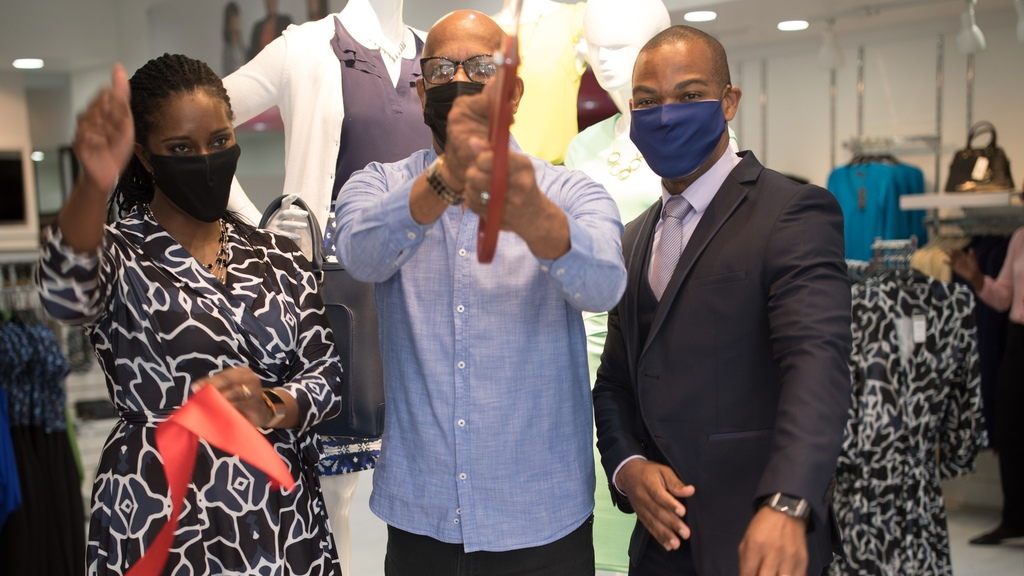 Joanna and Keron James at the opening of the new store in San Fernando with Mayor Junia Regrello. Photo: J&K Signature Styles