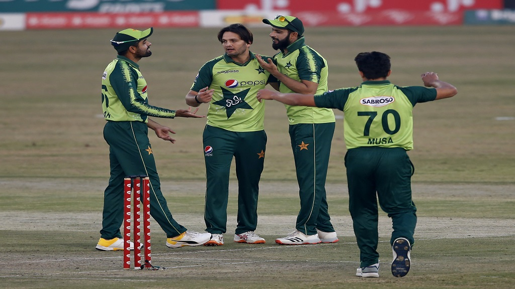 Pakistani spinner Usman Qadir, centre, celebrates with teammates after taking the wicket of Zimbabwe's batsman Elton Chigumbura during their 3rd Twenty20 cricket match at the Pindi Cricket Stadium, in Rawalpindi, Pakistan, Tuesday, November 10, 2020. (AP Photo/Anjum Naveed).