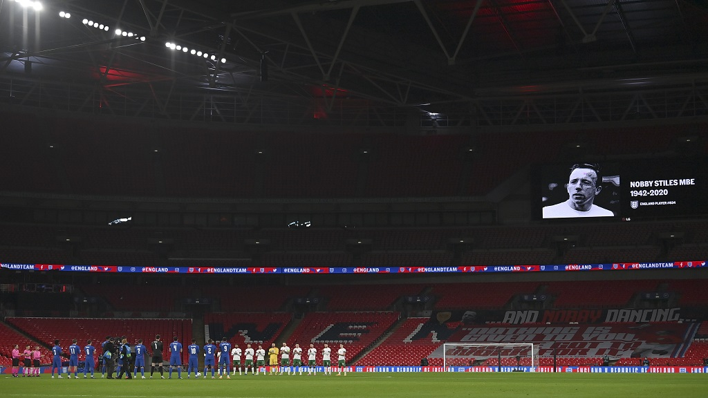 Players applaud in memory of the life of the late England football great Nobby Stiles who recently died, before the international friendly match between England and Ireland at Wembley stadium in London, England, Thursday Nov. 12, 2020. (Ben Stansall/Pool via AP).