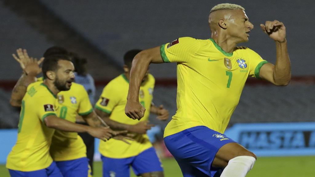Brazil's Richarlison celebrates after scoring his side's 2nd goal during a qualifying football match for the FIFA World Cup Qatar 2022 against Uruguay at the Centenario stadium In Montevideo, Uruguay, Tuesday, Nov. 17, 2020. (Raul Martinez/Pool via AP).