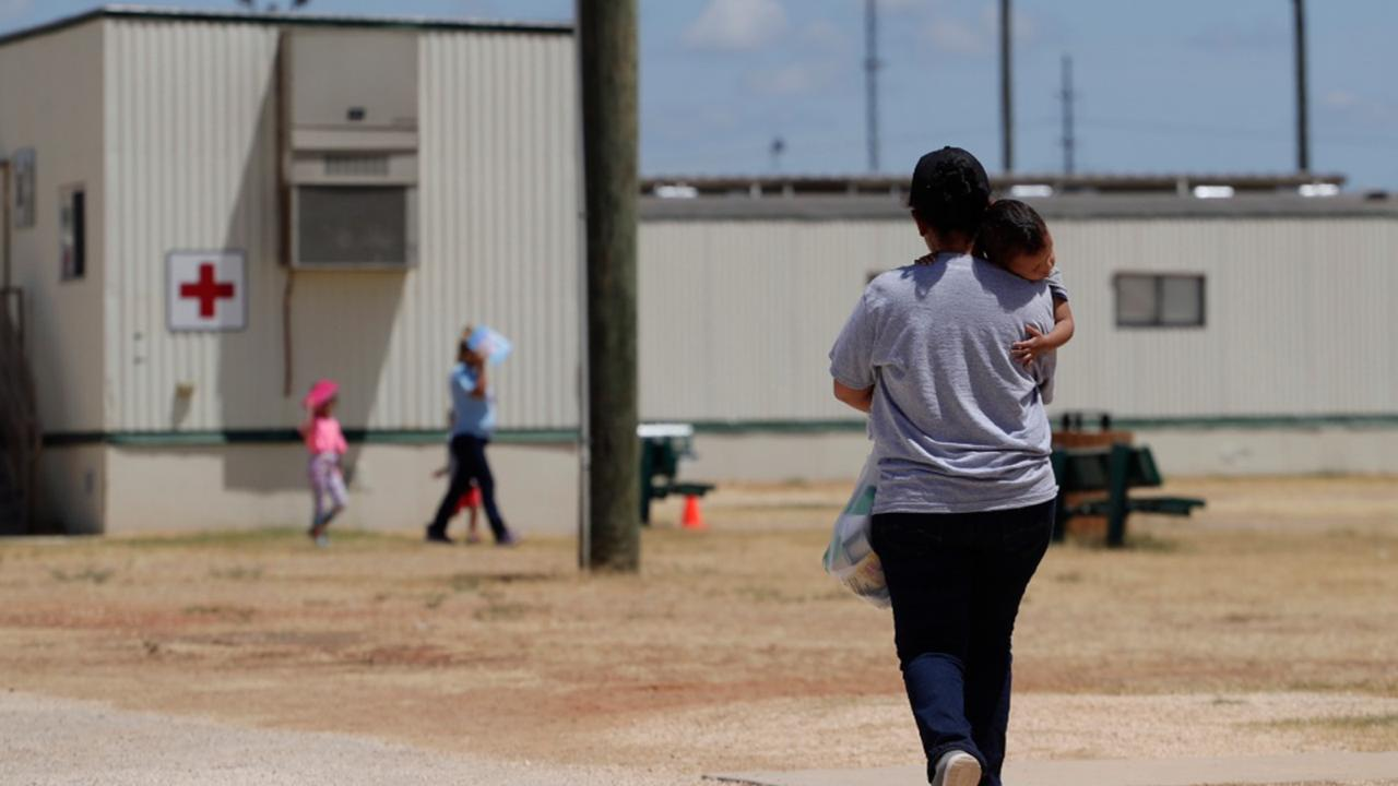 In this Aug. 23, 2019 file photo, immigrants seeking asylum walk at the ICE South Texas Family Residential Center, in Dilley, Texas.(AP Photo/Eric Gay, File)