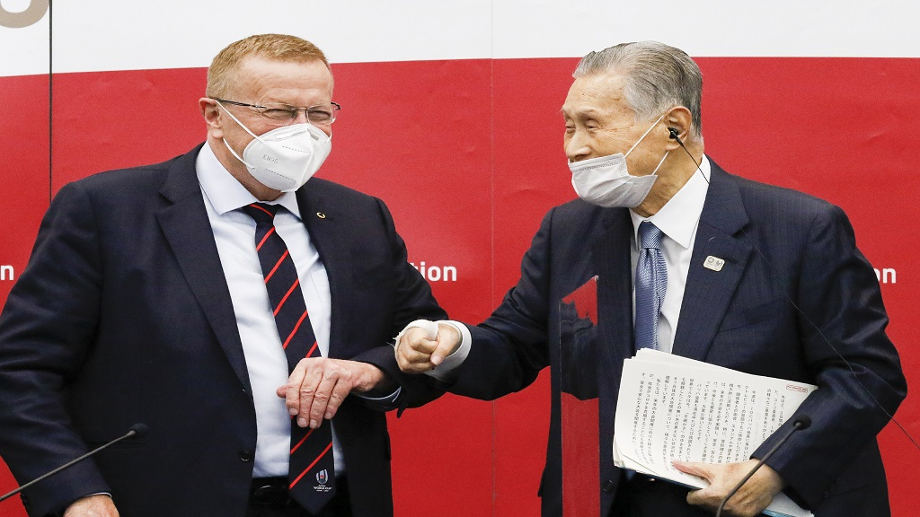 Yoshiro Mori, president of the Tokyo 2020 organising committee, right, greets John Coates, chairman of the Coordination Commission for the Tokyo 2020 Olympics, during a press conference in Tokyo, Wednesday, Nov. 18, 2020. (Rodrigo Reyes Marin/Pool Photo via AP).