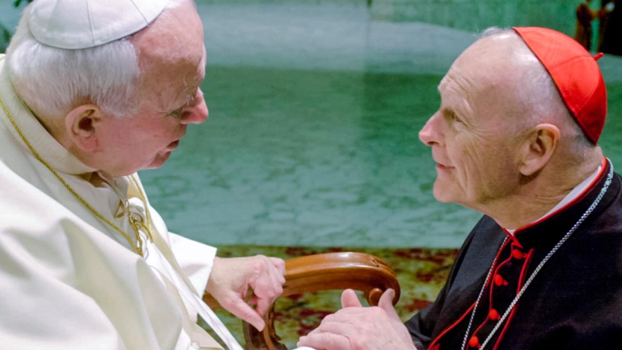 In this February 23, 2001 file photo, US Cardinal Theodore Edgar McCarrick, archbishop of Washington, DC, shakes hands with Pope John Paul II during the General Audience with the newly appointed cardinals in the Paul VI hall at the Vatican. (AP Photo/Massimo Sambucetti, File)