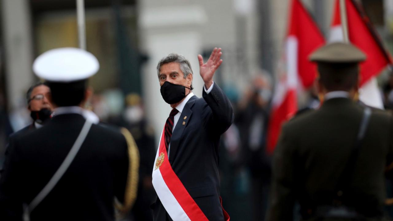 Francisco Sagasti waves after being sworn-in as the new, interim president at Congress in Lima, Peru, Tuesday, November 17, 2020. Sagasti's appointment marks a tumultuous week in which thousands took to the streets outraged by Congress' decision to oust popular ex-President Martín Vizcarra. (AP Photo/Rodrigo Abd)