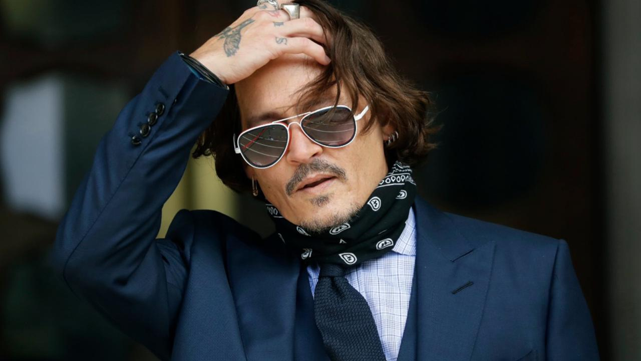 In this Tuesday, July 14, 2020 file photo, American actor Johnny Depp gestures to the media as he arrives at the High Court in London.(AP Photo/Matt Dunham, file)