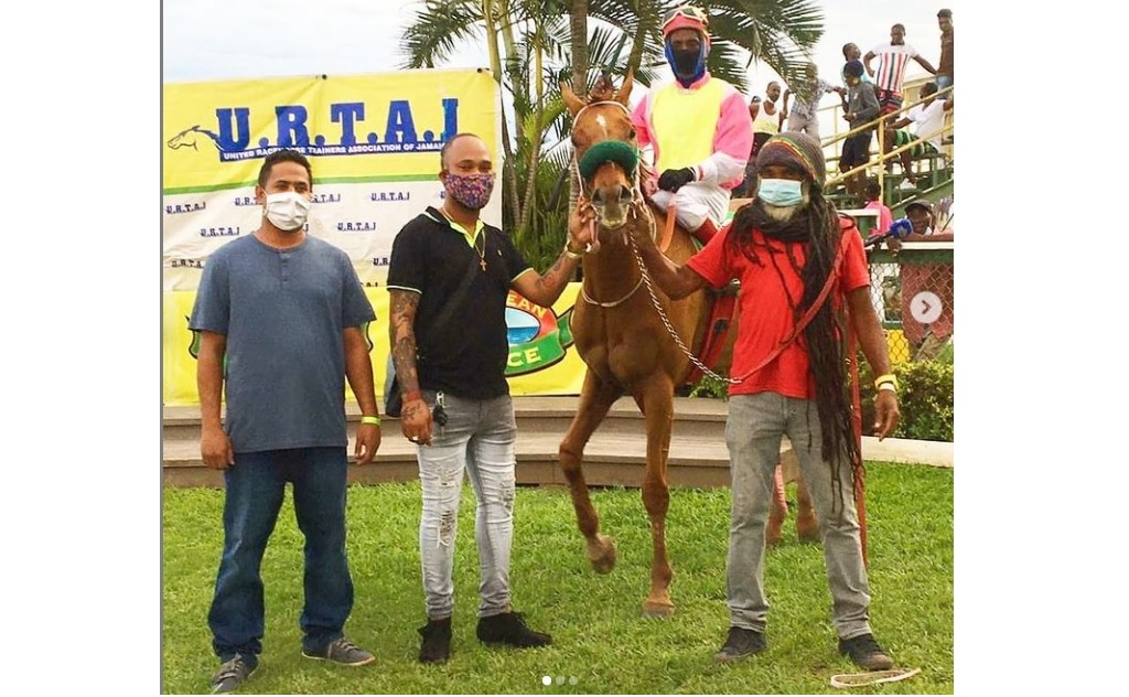 JAMAI RAJA (Devon A. Thomas) poses with connections inside the winners' enclosure after capturing the United Racehorse Trainers Association of Jamaica Trophy at long odds of 24-1 at Caymanas Park on Saturday, November 21, 2020. (PHOTO: caymanasracing).