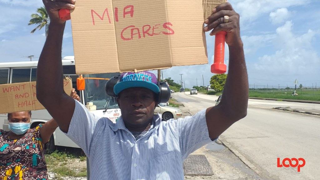 Former Caribbean Aircraft Handling employee Rodney Williams protesting opposite Grantley Adams Airport