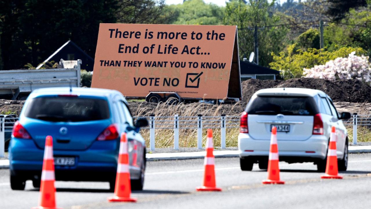 """In this Oct. 16, 2020, file photo, cars are driven past a billboard urging voters to vote """"No"""" against euthanasia in Christchurch, New Zealand. New Zealanders have voted on Friday, October 30, 2020, in favour of legalising euthanasia in a binding referendum. But in preliminary results, they were rejecting a measure to legalize marijuana. (AP Photo/Mark Baker, File)"""