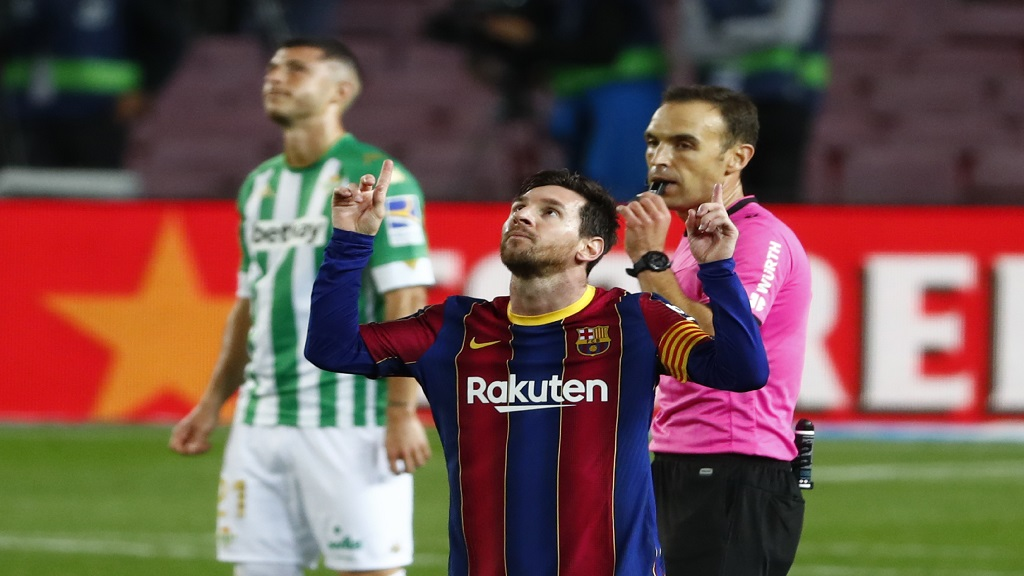 Barcelona's Lionel Messi celebrates after scoring his side's fourth goal during the Spanish La Liga football against Betis at the Camp Nou stadium in Barcelona, Spain, Saturday, Nov. 7, 2020. (AP Photo/Joan Monfort).