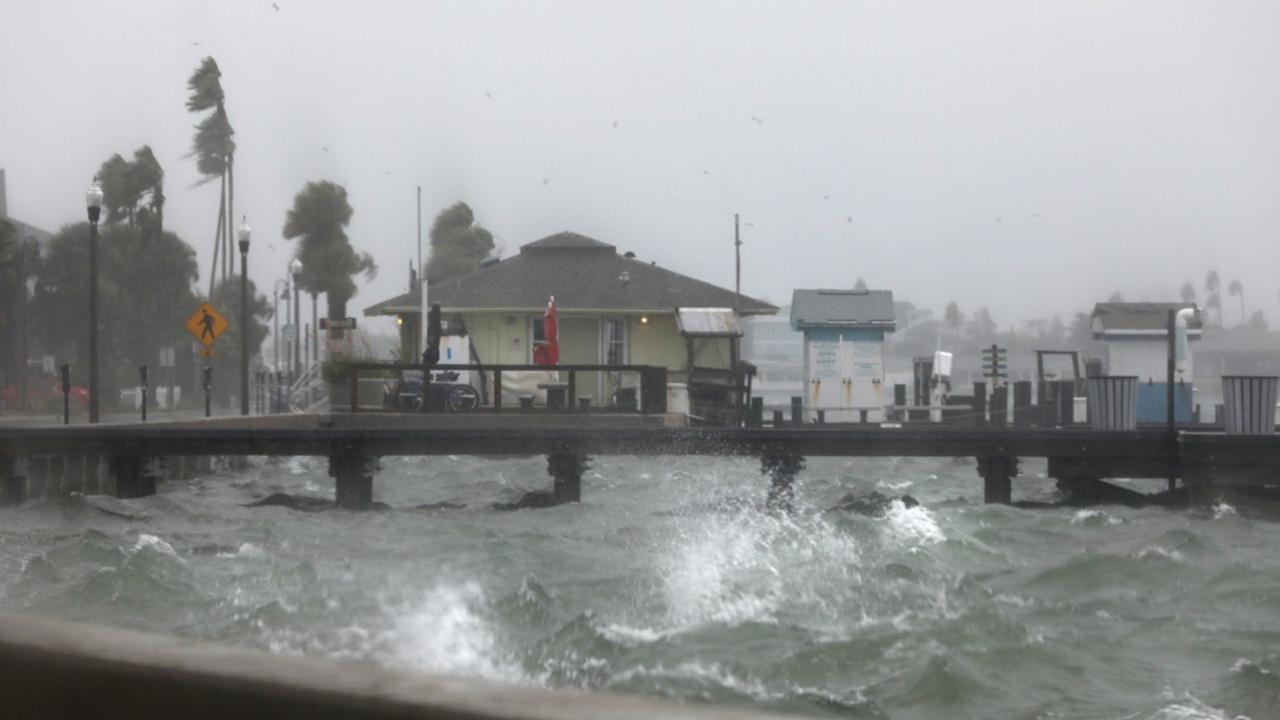 Water splashes against the seawall along Pass A Grille Way in St. Pete Beach, Florida on Wednesday, November 11, 2020, as squalls from Tropical Storm (Scott Keeler/Tampa Bay Times via AP)