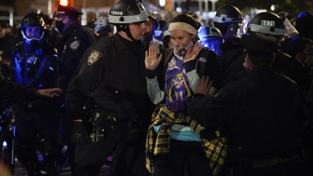 New York Police officers accost demonstrators in the West Village, Wednesday, Nov. 4, 2020, in New York. (AP Photo/Seth Wenig)