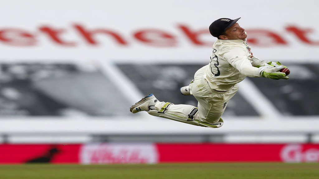 In this file photo dated Sunday, August 23, 2020, England's wicketkeeper Jos Buttler dives to take the catch to dismiss Pakistan's Shaheen Afridi during the third cricket Test match, at the Ageas Bowl in Southampton, England. England's cricketers are now in South Africa for a series comprising three Twenty20 games and three one-day internationals.(AP Photo/Alastair Grant, FILE).