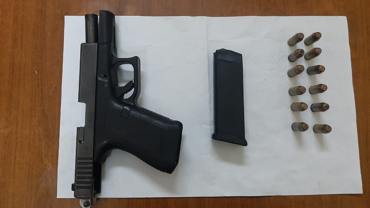 A Glock pistol loaded with 12 rounds of .40mm ammunition which was seized by police.